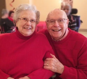 Close-up of smiling senior couple in assisted living facility
